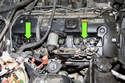 Remove two 8mm ignition wiring harness ground fasteners.