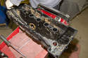 Thoroughly clean valve cover, then install new gasket into gasket recess in valve cover.