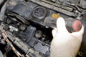 Using a flathead screwdriver, gently lever gasket out of valve cover.