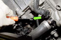 If sensor does not slide out easily, use a small flathead screwdriver and lever sensor out of cylinder head.