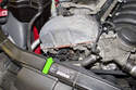 The exhaust camshaft position sensor is located on the right front side of the cylinder head.