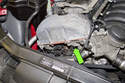 The intake camshaft position sensor is located on the left side of the cylinder head.