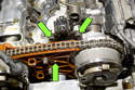Once valve cover has been removed, you will have to remove the eccentric shaft sensor fasteners (green arrows).