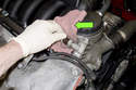 As you remove the sensor, a small amount of engine oil may leak out.