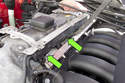 Then release the fuel injector harness strip from the fuel injectors.