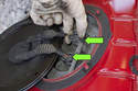 Disconnect fuel pump electrical connectors by squeezing release tabs and pulling off.