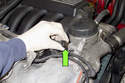Working at oil filter housing, disconnect oil pressure sensor by pressing retaining spring and pulling off.