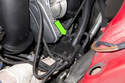 The wiring harness junction box (green arrow) is held on by two tabs on the metal mounting bracket.