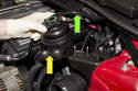Remove power steering reservoir (green arrow) from mounting bracket and guide under vacuum hose (yellow arrow) and lay aside.