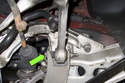 Next, working at subframe, remove control arm 21mm fastener.