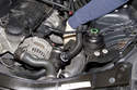 First you will have to remove the power steering reservoir from its mounting bracket.