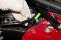 Remove power steering reservoir (green arrow) from mounting bracket and guide under vacuum hose (yellow arrow) and move toward area where air filter housing mounts.