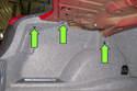 Working in trunk, remove three plastic rivets.