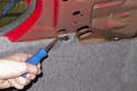 To remove the rivets, lever center tab out using a trim panel tool.