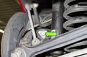Working at traction strut on brake rotor side, loosen 18mm fastener.