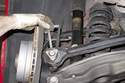 Next, remove stabilizer link from vehicle.
