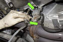Next, remove the oxygen sensor electrical connectors from the mounting bracket at right side of transmission.