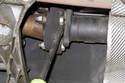 Using a prybar or large flatblade screwdriver, lever driveshaft away from transmission.