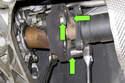 Next, working at transmission flange side, remove three driveshaft flex-disc mount fasteners.