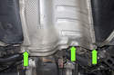 Working at the rear heat shield, remove three 10mm fasteners (green arrows).