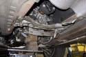 Place a floor jack under the transmission.