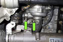 Working at the back of your water pump on right side of engine, loosen both hose clamps (green arrows)