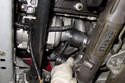 Once the hose clamps are loose, remove the hoses from the water pump.
