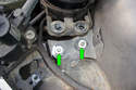 Be careful not to lose the two bushings (green arrows) that fit into the rubber mounts.