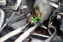 Loosen the 13mm securing nut that holds the bracket which holds the oil lines in place in the oil filter housing.