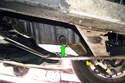 Use a 17mm wrench or socket with a ratchet to remove the drain plug (green arrow) and drain the engine oil into a drain pan.