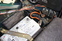 Disconnect the battery negative terminal to open the circuit and remove all electrical power from the car.