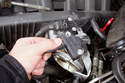 Squeeze the retaining clip on the ASC throttle position sensor and pull the connector away from the sensor.