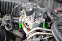 Remove the two 5mm Allen head fasteners (green arrows) that secure the ASC throttle body to the main throttle body.