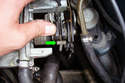 Position the throttle body so you have access to the throttle cables under the unit.