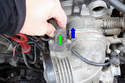 Squeeze the connector for the ASC throttle position sensor (green arrow) and pull the connector in the direction of the blue arrow.