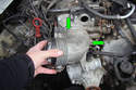 Remove the two T30 Torx fasteners (green arrows) that hold the ASC throttle body onto the main throttle body and then pull the ASC throttle body off of the engine.