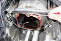 Use a pick to remove the throttle body to intake manifold gasket.