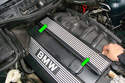 On the top of the fuel rail cover use a pick to remove the mounting bolt covers (green arrows).