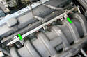 Remove the two 10mm fasteners (green arrows) that mount the fuel rail to the intake manifold.