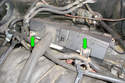 Loosen the two 10mm fasteners (green arrows) that hold the left side injector connector housing to the intake manifold.