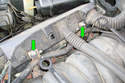 Loosen the two 10mm fasteners (green arrows) that hold the right side injector connector housing to the intake manifold.
