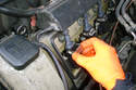Pull out the coil retaining clip on each coil connection on both sides of the engine.