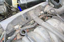 Lift up on the right side injector connector housing to unplug all the injectors on the right side.