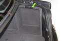The battery in BMW E39 models is located in the right side of trunk, behind a trim panel.