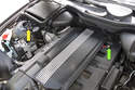 If you have a 6-cylinder model, the battery junctions are located at right front strut tower and the rear of the intake manifold, green arrow points to positive, yellow points to negative.