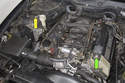 If you have an 8-cylinder model, the battery junctions are located at right front strut tower and the left front valve cover, green arrow points to positive, yellow points to negative.