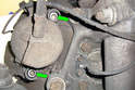 Replacing Front Calipers-Using a 7mm Allen key bit remove the two caliper mounting pins (green arrows).