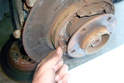 Once loose from the backing plate pull the hold down spring out of the brake shoe.