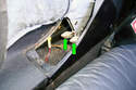 Pull up parking brake lever boot over the parking brake handle to move it out of the way.