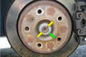 Rear Wheel Bearing-With a sharp punch tap out the pinch (yellow arrows) of the axle shaft nut.